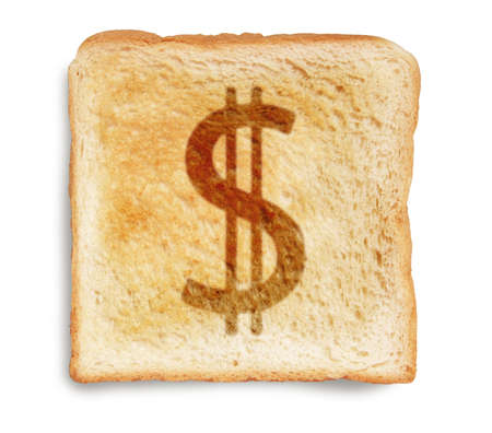dollar sign burn mark on toast bread, isolated on white background photo
