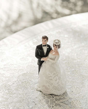 miniature people: wedding bride and groom couple doll on lace table  Stock Photo