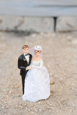 wedding doll couple on street background  photo