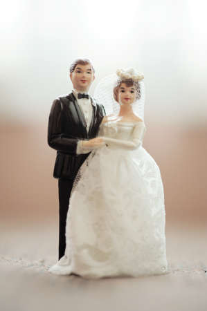 small cake: wedding bride and groom couple doll with blur background