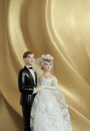 wedding couple doll on gold background  photo