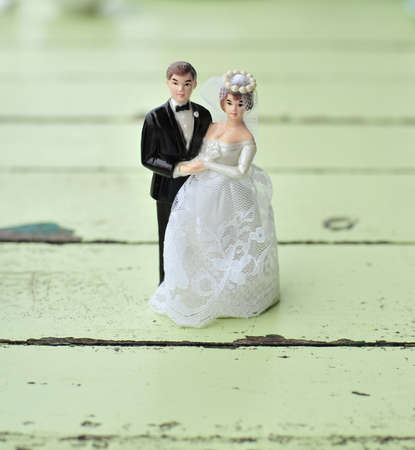 wedding doll on green wood table photo