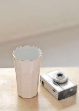 coffee cup with vintage toy camera photo