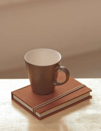 brown cup tea: coffee cup with diary