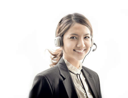 asian woman with headphone , communication operator on white background photo
