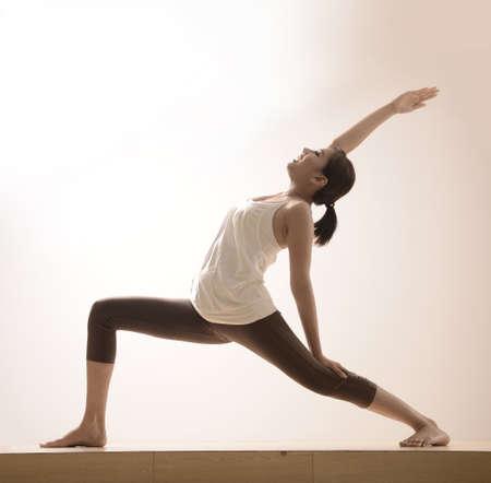 thai yoga: beautiful asian girl with yoga pose Stock Photo