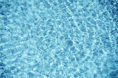 blue water ripple texture of swimming pool photo