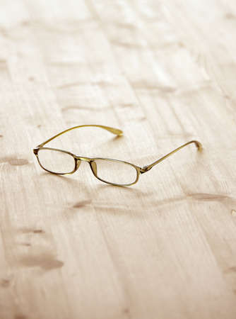 eyeglasses on wooden board photo