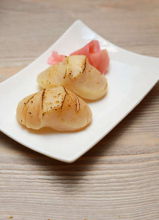 hotate: sushi hotate, scallop, sheer in white plate