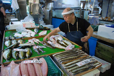 TOKYO - JULY 17   Fish seller at Tsukiji Market, the biggest wholesale market in Japan, market will be moved to new location in 2014, July 17, 2008 in Tokyo, Japan