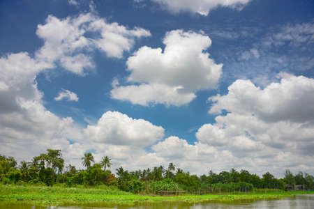 Blue sky with cloud and river bank Stock Photo - 22975017