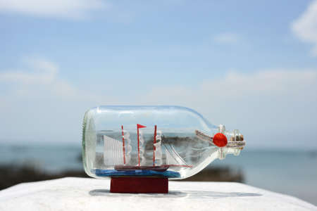 sail ship model in glass bottle with summer sea background Stock Photo - 22975053