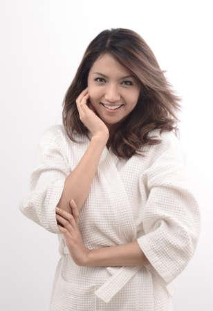 Asian woman in bathrobe , morning mood photo