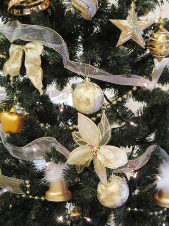christmas tree closeup with gold and silver ornament