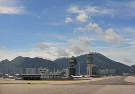airport runway: HONGKONG - JULY 7 : Hong Kong International Airport, Chek Lap Kok Airport taken July 7, 2009. This airport is main airport since 1998 replacing the former Kai Tak Airport.