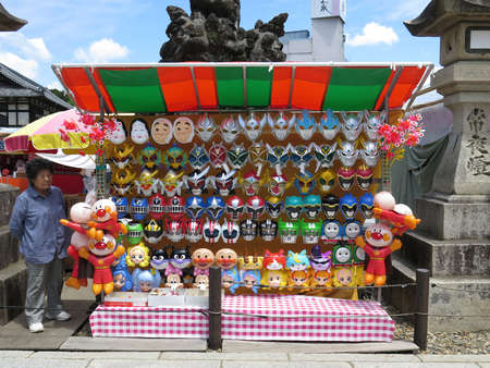 NARITA, JAPAN - MAY 30 : Mask shop in Narita Temple. Cartoon mask is popular toy among children in Japan. Editorial
