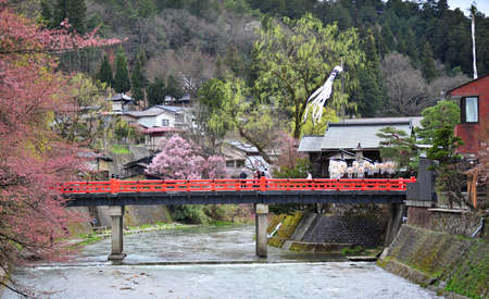 TAKAYAMA, JAPAN - APRIL 12 : Landmark of Takayama, red bridge taken April 12, 2010. Takayama is old town which is register as world heritage site.