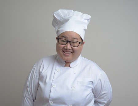 funny asian chef woman dress in white