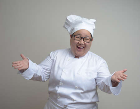 medium shot: funny asian chef woman dress in white