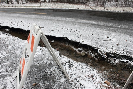 washed out: Washed out road with snow