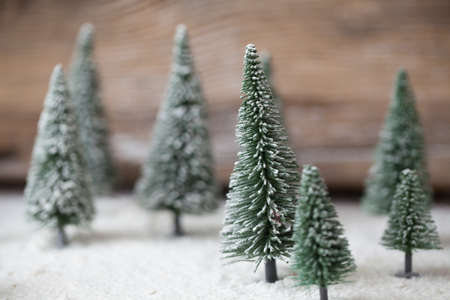 mountain scene: Christmas card - a miniature Christmas tree forest in the snow - winter