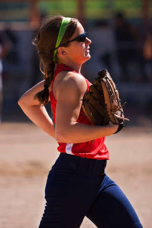Female Softball Player Jogs Off The Field