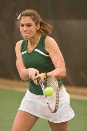 hits: Female Tennis Player Hits Backhand Stock Photo