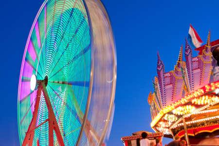 Ferris Wheel Movement Blurs Against Blue Sky