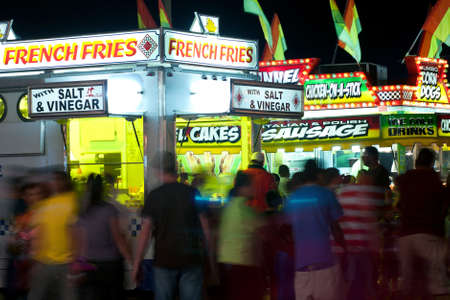 People Walk Amid Fast Food Vendors At County Fair  Stock Photo - 14963238