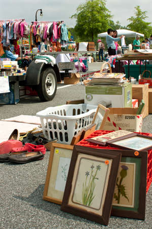 Lilburn, GA, USA - April 21:  Shoppers look over merchandise on display at the Lilburn citywide garage sale, held in the city hall parking lot. Stock Photo - 15056024