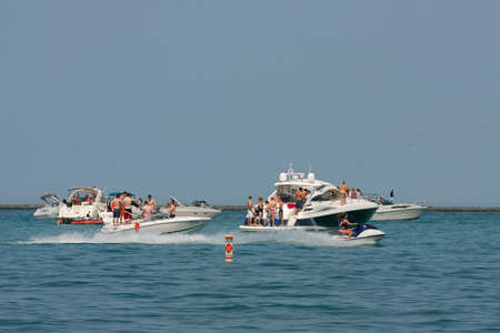 lake shore drive: CHICAGO, IL - MAY 26:  Dozens of unidentified people party on boats anchored in Lake Michigan over Memorial Day weekend. The scene took place just off the shoreline of Chicagos famous Lake Shore Drive.  Thousands of people enjoyed the outdoors as the Mem Editorial