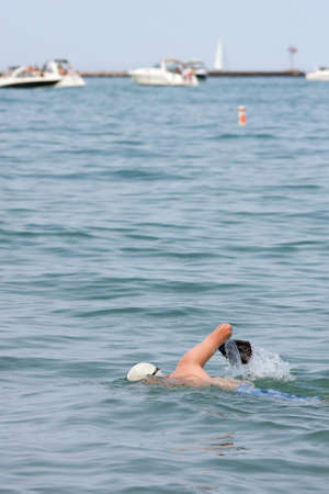 lake shore drive: CHICAGO, IL - MAY 26:  A male swimmmer works out by swimming freestyle stroke in Lake Michigan over the Memorial Day holiday weekend. This scene is just off the shoreline that runs along Chicagos famous Lake Shore Drive.  Thousands of people came outdoor