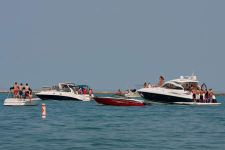 lake shore drive: Chicago, IL, USA - MAY 26, 2012:  Dozens of unidentified people party on boats anchored in Lake Michigan over Memorial Day weekend. The scene took place just off the shoreline of Chicagos famous Lake Shore Drive.  Thousands of people enjoyed the outdoors