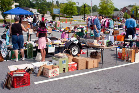 thrift box: Lilburn, GA, USA - April 21, 2012   Shoppers look for bargains amid the merchandise on sale at the Lilburn citywide garage sale