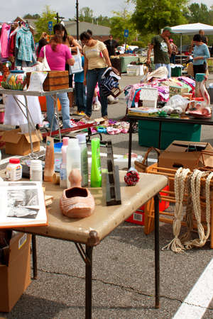 Lilburn, GA, USA - April 21:  Shoppers look over merchandise on display at the Lilburn citywide garage sale, held in the city hall parking lot. Stock Photo - 15056037