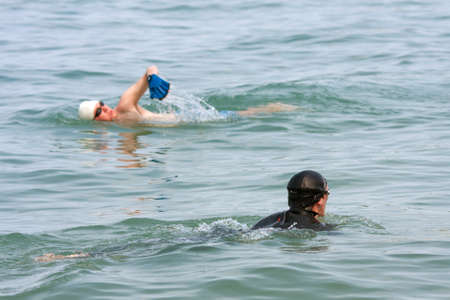 lake shore drive: CHICAGO, IL - MAY 26:  Two male swimmmers work out by swimming Lake Michigan over the Memorial Day holiday weekend. This scene is just off the shoreline that runs along Chicagos famous Lake Shore Drive.  Thousands of people came outdoors to kick off summ