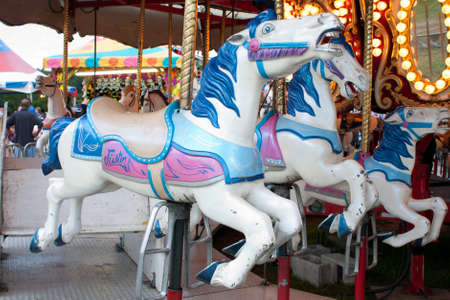 Lawrenceville, GA, USA - September 15, 2012:  Closeup of horses on the merry-go-round  on the midway at the Gwinnett County Fair. 新闻类图片