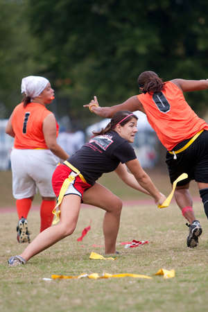football field: Atlanta, GA, USA - September 29, 2012:  An unidentified woman tries to pull the flags off teammates during a practice drill for the Krush team of the Atlanta Women