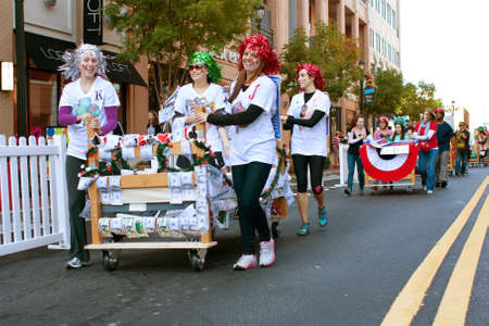 fundraiser: Atlanta, GA, USA - October 13, 2012:  Unidentified people parade their beds around the course before the start of the Atlanta Mattress 500, a fundraiser bed race for the Atlanta Furniture Bank.