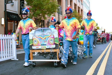 silliness: Atlanta, GA, USA - October 13, 2012:  Unidentified people parade their beds around the course before the start of the Atlanta Mattress 500, a fundraiser bed race for the Atlanta Furniture Bank. Editorial