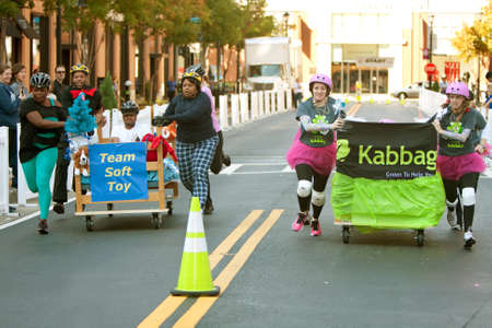 Atlanta, GA, USA - October 13, 2012:  Unidentified people push their teams beds down the street as they  race each other in the Atlanta Mattress 500, a fundraiser bed race for the Atlanta Furniture Bank. Editorial