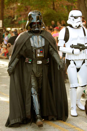 Atlanta, GA, USA - October 20, 2012:  Darth Vader and stormtrooper walk the parade route at the Little Five Points Halloween parade. The L5P parade is one of the largest in the southeast.