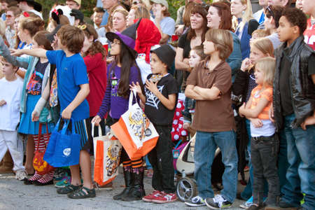 Atlanta, GA, USA - October 20, 2012:  Kids and families line the street in anticipation of getting candy during the Little Five Points Halloween parade.  The L5P parade is one of the largest Halloween parades in the southeast.  Stock Photo - 16979336