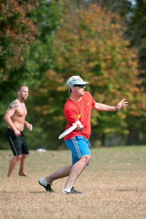 Atlanta, GA USA - October 27, 2012:  An unidentified young male prepares to throw a frisbee during an Ultimate Frisbee game between two teams in Piedmont Park. Editorial