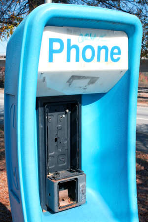 80 s: Atlanta, GA - November 17, 2012  An out of service public phone stands as a reminder of what it was like before cell phones  Editorial