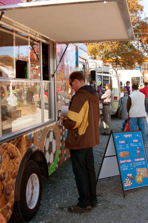 Atlanta, GA - November 17, 2012:  An unidentified customer buys food from a high-end food truck at the Atlanta Food Truck Park.