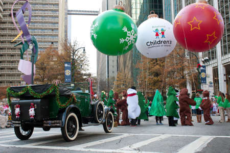 Atlanta, GA, USA - December 1, 2012:  People in costumes with floats gather at the start of the annual Atlanta Christmas parade in downtown Atlanta.