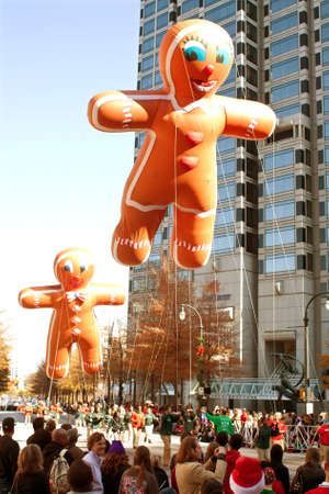 Atlanta, GA, USA - December 1, 2012:  Two inflated gingerbread man balloons move through the parade route at the annual Atlanta Christmas parade in downtown Atlanta.