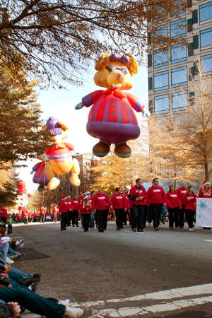 Atlanta, GA, USA - December 1, 2012:  Large inflated balloon characters and volunteers move through the parde route at the annual Atlanta Christmas parade in downtown Atlanta.