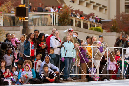 larger than life: Atlanta, GA, USA - December 1, 2012:  Spectators watch from the street curb as the Atlanta Christmas parade takes place down Peachtree Street in downtown Atlanta. Thousands were on hand for the annual event.  Editorial